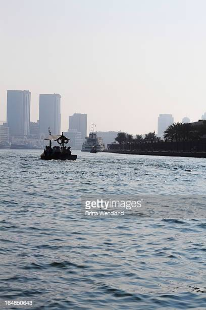 People on water taxi along Dubai creek, Dubai, United Arab Emirates