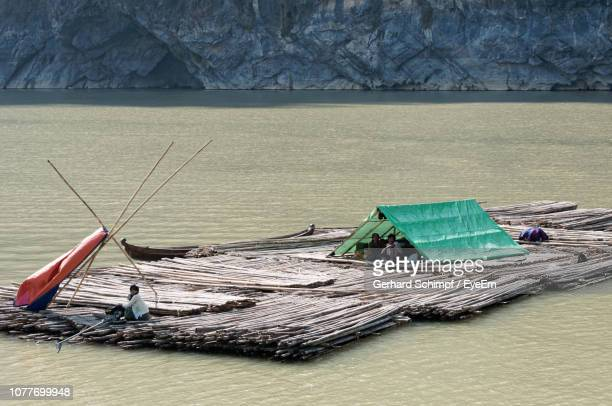people on wooden rafts in lake - gerhard schimpf stock pictures, royalty-free photos & images