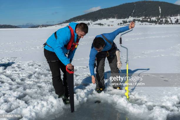 People On Working On Snow Field