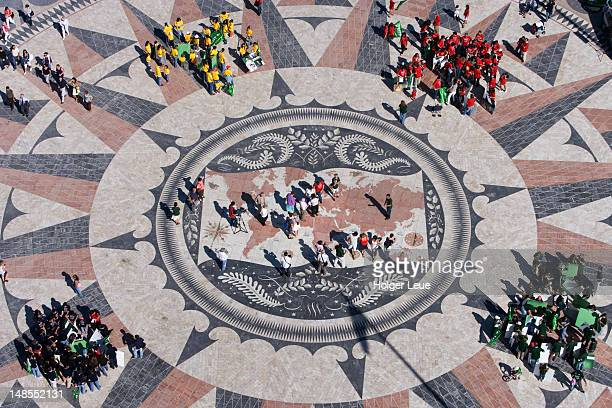People on world mosaic map seen from top of Discoveries Monument (Padrao dos Descobrimentos).
