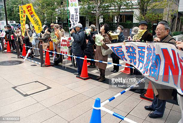 People oppose to nuclear power plants restart protest in front of the Nuclear Regulation Authority building on March 13 2014 in Tokyo Japan 17...