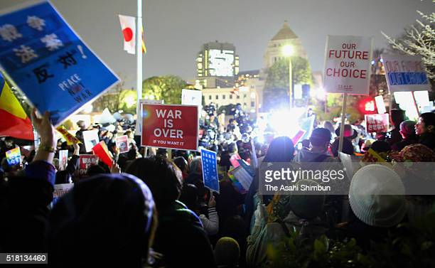 People opposing to the new national security laws demonstrate in front of the diet building on March 29, 2016 in Tokyo, Japan. The national security...