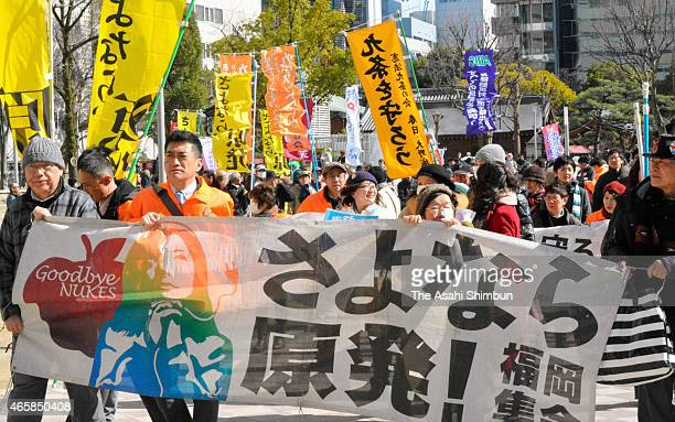 People opposing to the restart of nuclear power plants march on during a rally on March 11 2015 in Fukuoka Japan
