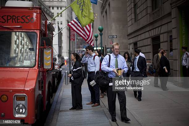 People order coffee from a food truck on Wall Street near the New York Stock Exchange June 5 2012 in New York City