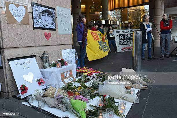 People organize a protest in front of Immigration and Border Protection office as a Somalian female refugee and Iranian male refugee set themselves...