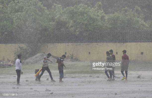 People out in pre-monsoon raining weather at Gandhi Nagar, on July 2, 2021 in New Delhi, India. Rainfall lashed parts of the national capital on...