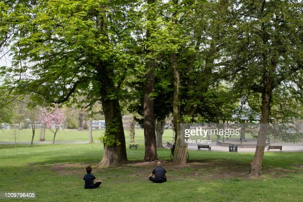 People out meditating and applying social distancing in Canon Hill Park as Coronavirus is felt on a local level on 12th April 2020 in Birmingham,...
