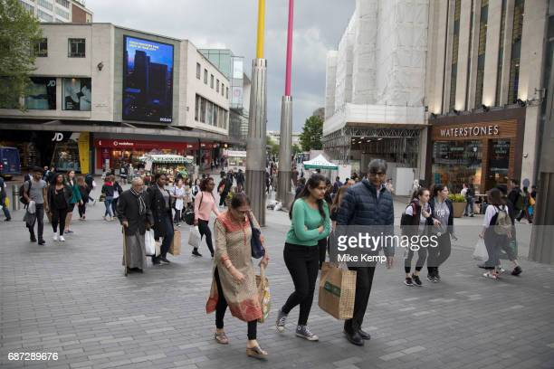 People out shopping in the public outdoor space at the Bullring in Birmingham, United Kingdom. The Bullring is a major commercial area of central...