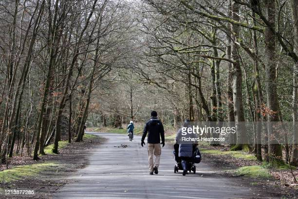 People out walking in Burnham Beeches on March 21 2020 in Burnham United Kingdom The National Trust a charitable organisation that manages private...
