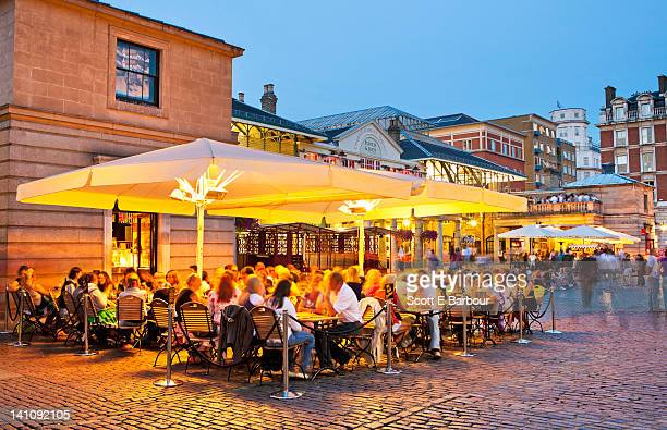 People outdoor dining in Covent Garden