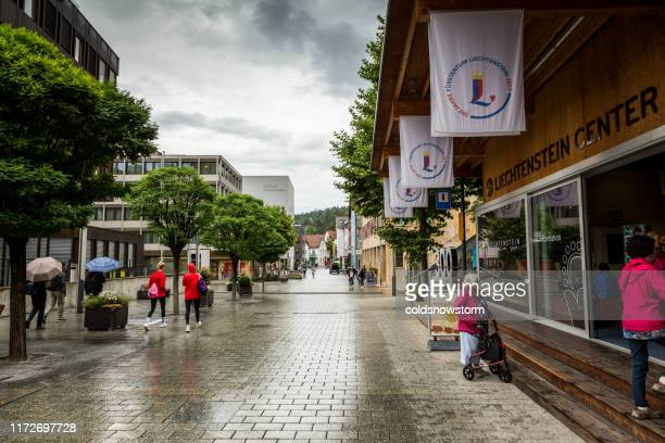 people outdoors on street in vaduz, liechtenstein - vaduz stock pictures, royalty-free photos & images