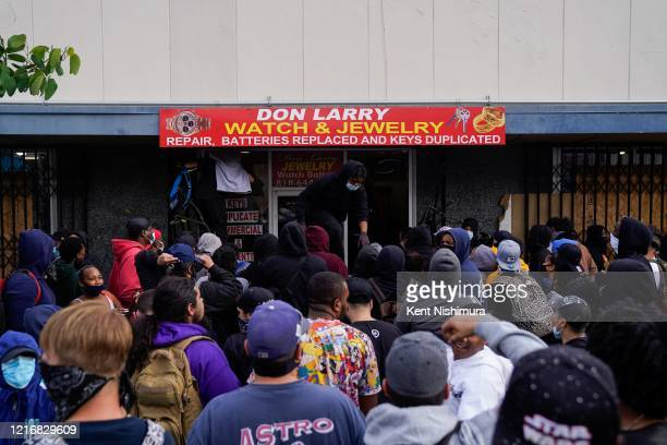 People outside a store on June 1, 2020 in Van Nuys, CA. Protests erupted across the country, with people outraged over the death of George Floyd, a...