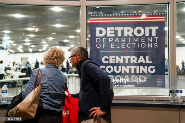 People outside Detroit Department of Elections Central Counting Board of Voting absentee ballot counting center at TCF Center, Wednesday, Nov. 4,...