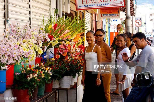 People outside flower shops of Bourbon Street.