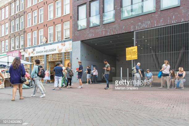 people outside metrostation de pijp at albert cuypstraat - merten snijders stock pictures, royalty-free photos & images