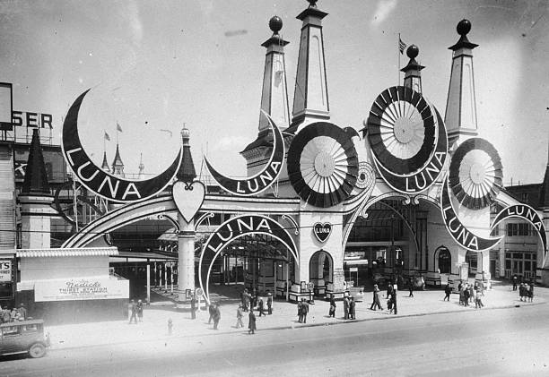 People outside the entrance to Luna Park on Coney Island,...
