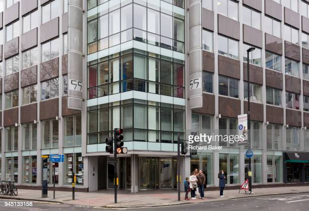People outside the offices of Cambridge Analytica on New Oxford Street the UK tech company accused of harvesting the personal details of Facebook...