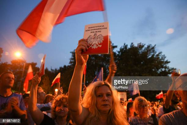People outside the Regional Court during ' Chain of Light ' during another day of protests against government plans for sweeping changes to Polands...