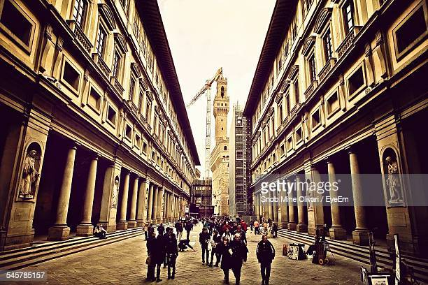 People Outside Uffizi Gallery With Palazzo Vecchio In Background