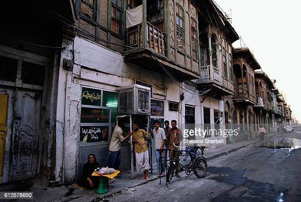 People Outside Weathered Buildings