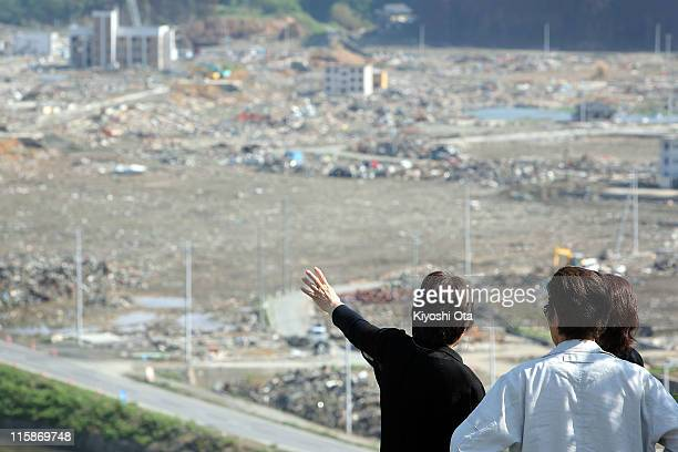 People overlook the destroyed town on June 11 2011 in Minamisanriku Miyagi Japan The Japanese government has been struggling to deal with the...