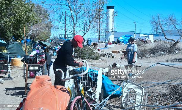 People pack their belongings at a homeless encampment beside the Santa Ana River on February 20 2018 in Anaheim California Officials in Orange County...