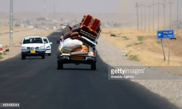 People packing their stuff flee from Makhmur to Arbil following Peshmerga forces' seizure of Makhmur by repelling Islamic State formerly known as...