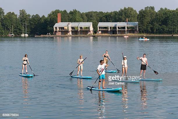 People paddleboarding on lake in Trakai, Lithuania