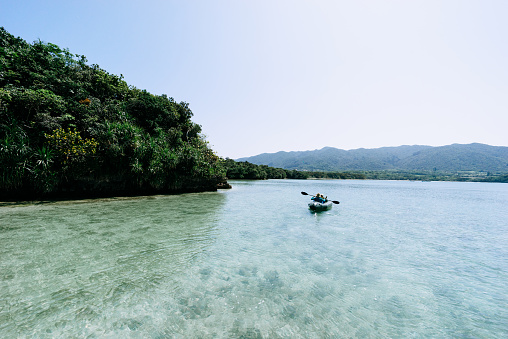 People paddling kayak on clear tropical water, Ishigaki Island, Okinawa, Japan - gettyimageskorea