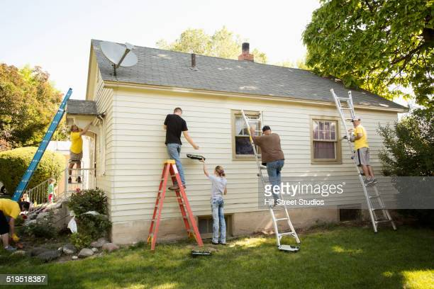people painting house - community building stock pictures, royalty-free photos & images