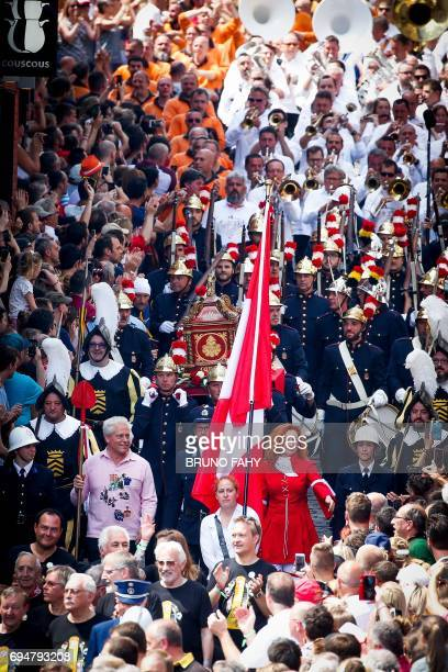 People parade as they take part in the Ducasse Doudou folkloric festival in Mons on June 11 2017 The Doudou festival was recognised in 2005 by the...