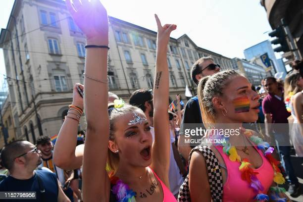 People parade during the Milan Pride 2019 on June 29 2019 in Milan as part of the LGBT Pride month marking the 50th anniversary of the New York...