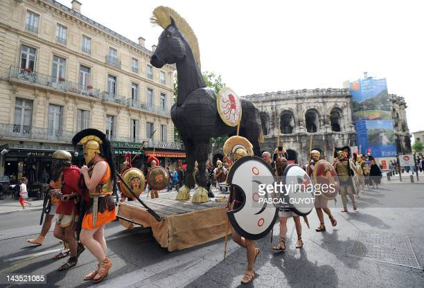 ZAKA People parade with a Trojan horse during an historical reenactment in front of the amphitheatre as part of the third edition of the Roman Games...