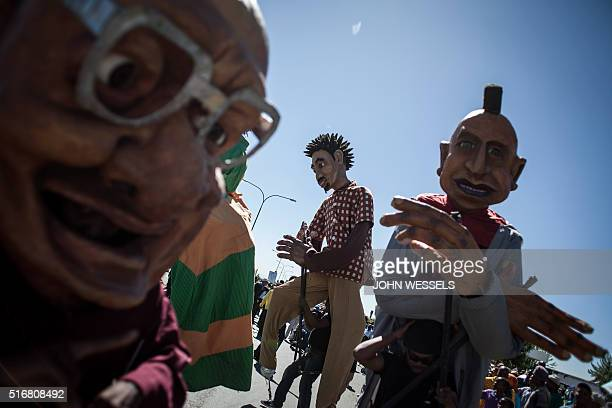 People parade with woden giant model during the Gauteng United Against Racism march on Human Rights Day 21 March in Sharpeville Human Rights day is...
