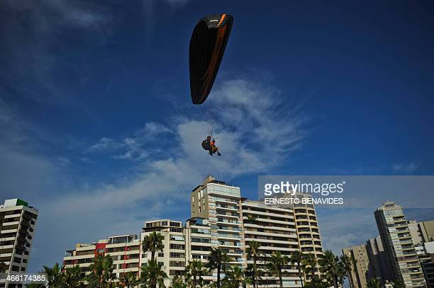 People paraglide from Lima cliffs on January 31 2014 The edge of a cliff in Miraflores Lima is the entrance to heaven for paragliding lovers who rush...