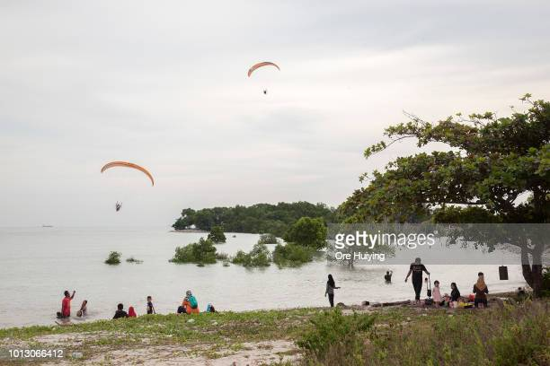 People paraglide near the 234 acre land acquired by 1MDB fund in Pulah Indah on July 29 2018 in Selangor Malaysia Malaysia's former prime minister...