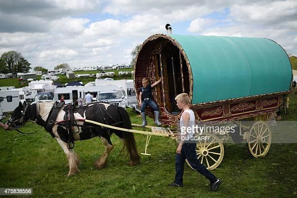 People park their vardo or horsedrawn caravan on the opening day of the annual Appleby Horse Fair in the town of ApplebyinWestmorland North West...