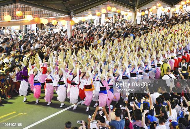People partake in the Awa Odori traditional dance festival in Tokushima Prefecture western Japan on Aug 13 2018 ==Kyodo