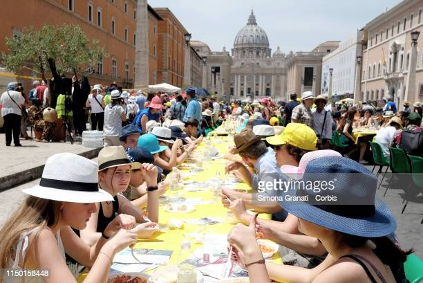 People partecipate at Italian Dinner without walls in Via della Conciliazione in front of St Peter's Basilica initiative cosponsored by Focsiv...