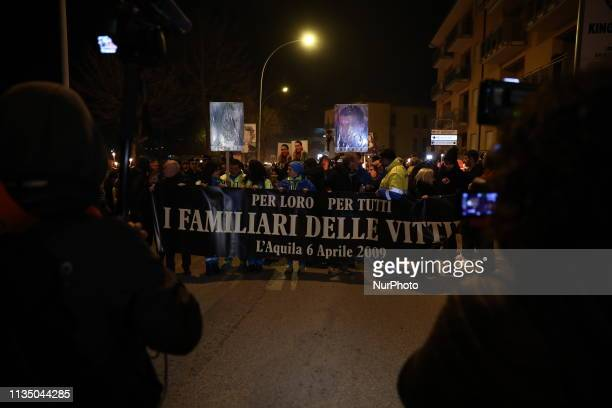 People partecipate in a candle rally in L'Aquila, on April 6, 2019 to commemorate the tenth anniversary of the major earthquake which struck the...