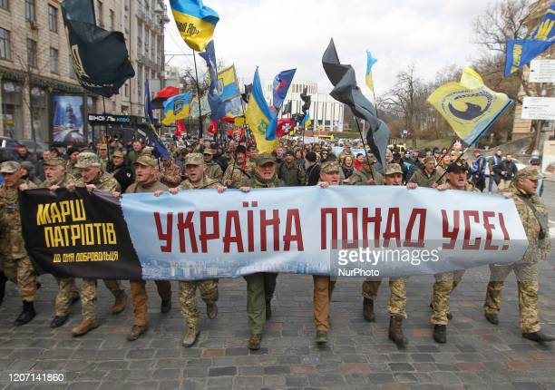 People participate at a rally called 'March of Patriots' at the Volunteer Day in honor of volonteer fighters who joined Ukrainian Army at a war...