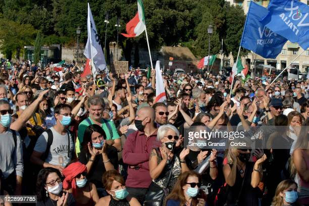 People participate at Let's Free Italy!, Liberation March for Work, Income, Sovereignty, Democracy, in Piazza San Giovanni on October 10, 2020 in...
