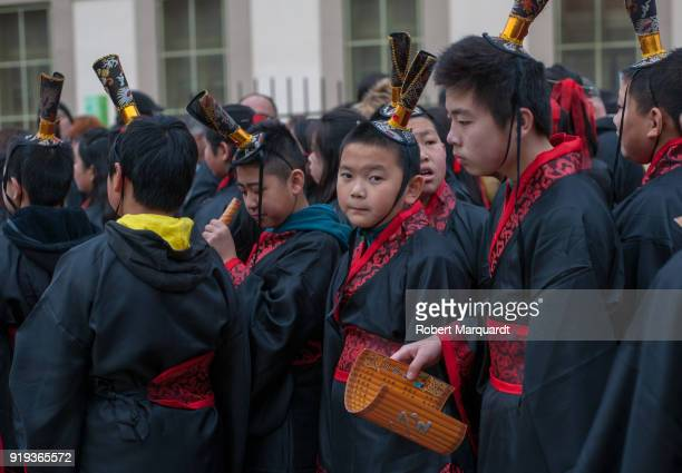 People participate during a parade for the Barcelona celebration of the Chinese Lunar New Year of the Dog on February 17 2018 in Barcelona Spain