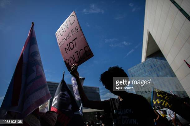 People participate in a Black Lives Matter protest near City Hall on the first anniversary of George Floyd's murder, May 25, 2021 in Los Angeles,...
