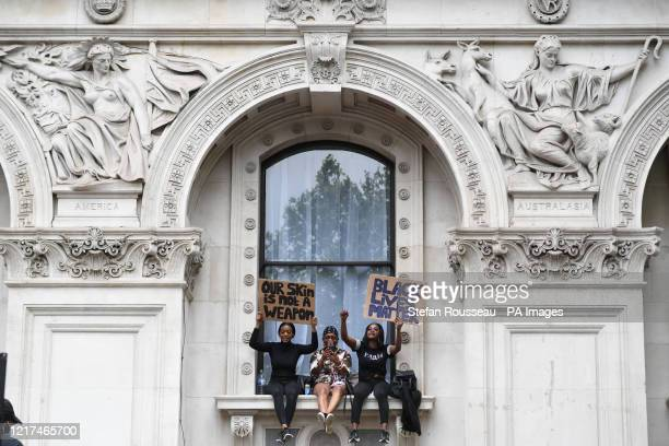 People participate in a Black Lives Matter protest rally outside the Foreign and Commonwealth Office London in memory of George Floyd who was killed...