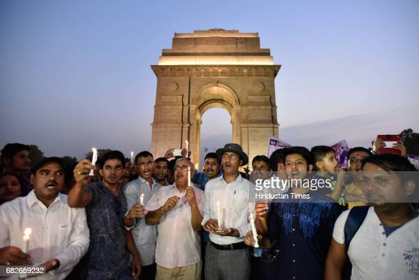 People participate in a candlelight march organized at India Gate to pay homage to Army officer Lieutenant Ummer Fayaz who was killed in Kashmir by...