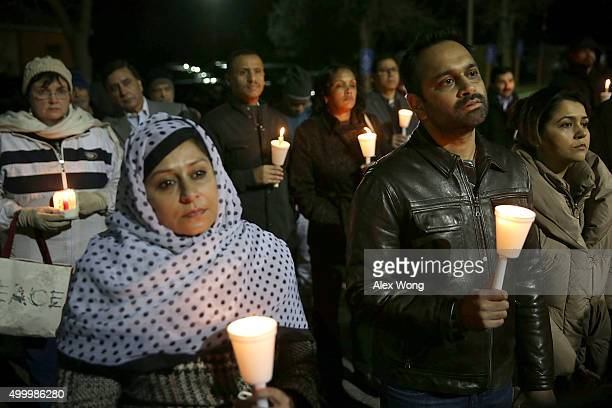 People participate in a candlelight vigil held by the Council on AmericanIslamic Relations for the victims in recent mass shootings December 4 2015...