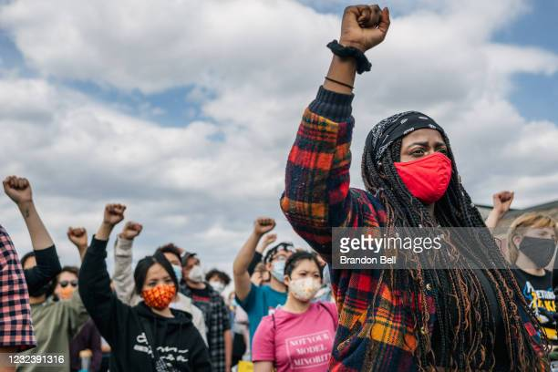 People participate in a chant during a demonstration in the intersection of 38th Street & Chicago Avenue on April 18, 2021 in Minneapolis, Minnesota....