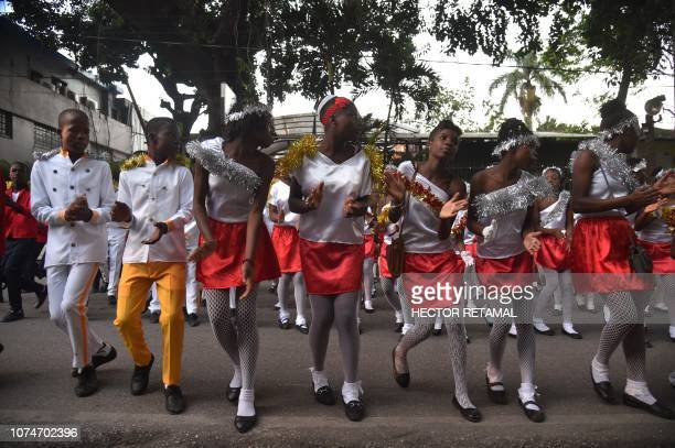 People participate in a Christmas Parade on the streets of the commune of Petion Ville in the Haitian capital PortauPrince on December 23 2018