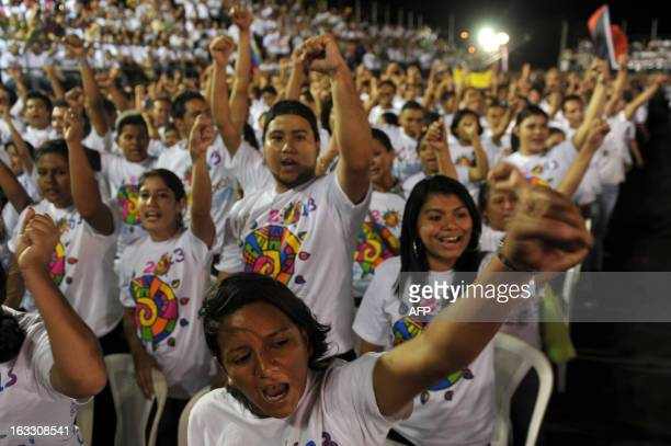 People participate in a concert in homage of the late President of Venezuela Hugo Chavez held at the Parque La Biblia in Managua on March 7 2013 AFP...